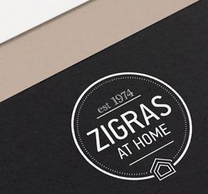 <span>Zigras at Home</span><i>→</i>
